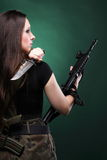 Sexy young woman long hair - gun knife Royalty Free Stock Images
