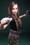 young woman long hair - gun knife Stock Photo