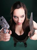 Sexy young woman long hair - gun knife Royalty Free Stock Photography