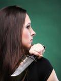 Sexy young woman long hair - gun knife Royalty Free Stock Image