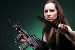 Sexy young woman long hair - gun knife Stock Photo