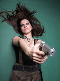 Sexy young woman long hair - gun Royalty Free Stock Image