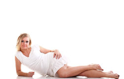 Sexy young woman long legs lying on floor Stock Photography