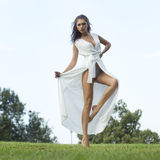 Sexy young woman in long white dress Royalty Free Stock Images