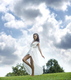 Sexy young woman in long white dress Stock Photos