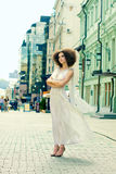 young woman in luxurious dress on the street Stock Images