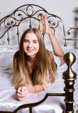 Sexy young woman lying on a bed Stock Images