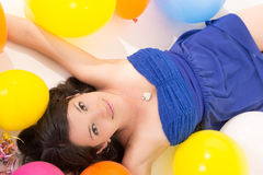 Sexy young woman lying on floor among balloons Stock Images