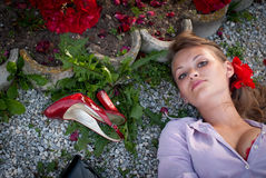Sexy young woman lying on the ground Stock Photos