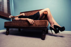 Sexy young woman lying on sofa Royalty Free Stock Photo