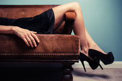 Sexy young woman lying on sofa Royalty Free Stock Photography