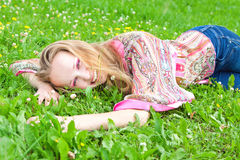 Sexy young woman in a meadow Stock Photos
