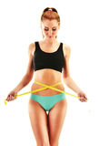 Sexy young woman measuring herself. Weight loss Royalty Free Stock Photo