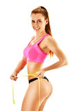 Sexy young woman measuring herself. Weight loss Royalty Free Stock Image