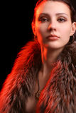 Young woman with moody light. Young woman over black background with moody light royalty free stock photos