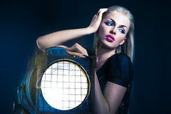 Sexy young woman with old floodlight Stock Images