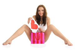 Sexy young woman with painted heart and gift bags Stock Photography