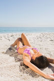 Sexy young woman in pink bikini sunbathing Royalty Free Stock Photography