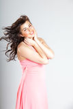 Sexy young woman in pink dress Royalty Free Stock Images