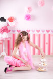Sexy young woman in pink room Stock Photography