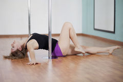 Sexy young woman pole dancing Royalty Free Stock Photography