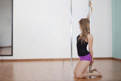 Sexy young woman pole dancing Stock Image