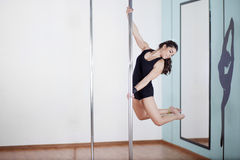 Sexy young woman pole dancing Royalty Free Stock Images