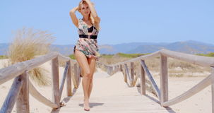 Sexy Young Woman Posing at the Beach Pathway stock footage