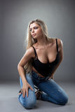 Sexy young woman posing in black and jeans Stock Photography