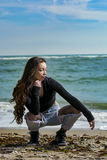 Young woman. Posing on Black Sea shore in a spring day stock photos