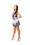young woman posing in a blue dress  Stock Images