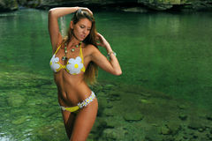 young woman posing in designer bikini at exotic location of mountain river Stock Images