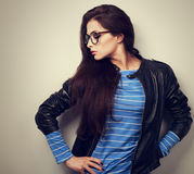 Sexy young woman posing in fashion black leather jacket and glas Stock Photography