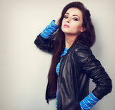 Sexy young woman posing in fashion black leather jacket. Toned c Stock Photo