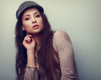 Sexy young woman posing in fashion grey cap. Color vintage portrait Royalty Free Stock Photography