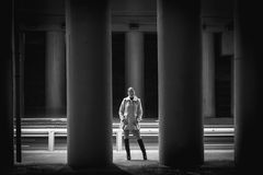 Sexy young woman posing between high columns under bridge. Black and white photo of sexy young woman posing between high columns under bridge Royalty Free Stock Photo