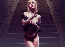 Young Woman Posing at Stairs Provocatively Stock Photography