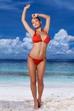 Sexy young woman in a red bikini at the beach Royalty Free Stock Photography