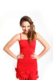 Sexy young woman in a red dress growling isolated on white Royalty Free Stock Image