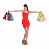 Sexy young woman in red dress with shopping bags Royalty Free Stock Images
