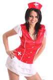 Sexy young woman in red fancy dress nurse costume Stock Photo