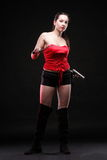 young woman - gun on black background Royalty Free Stock Photo