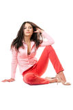 young woman in red jeans. Isolated Stock Photos