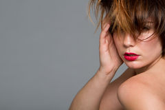 young woman with red lips and messy hair Royalty Free Stock Photography