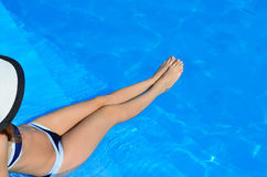 Sexy young woman relaxing in the pool, beautiful figure. Royalty Free Stock Photo