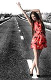 Sexy young woman on the road Royalty Free Stock Image