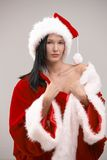 young woman in Santa costume Stock Image