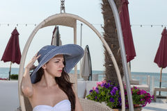 Sexy young woman at a seaside resort Stock Photos