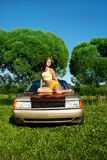 Sexy young woman sit on retro car Royalty Free Stock Image