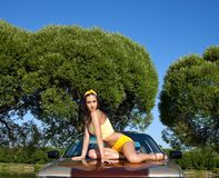 Sexy young woman sit on retro car Royalty Free Stock Photos